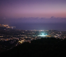 Panoramic View - City Lights and Sea